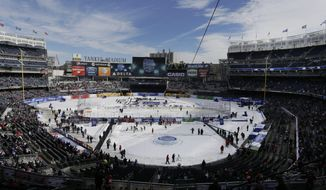 Fans wait for the start of an outdoor NHL hockey game between the New Jersey Devils and the New York Rangers Sunday, Jan. 26, 2014, at Yankee Stadium in New York. (AP Photo/Frank Franklin II)