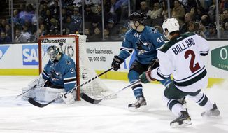 Minnesota Wild's Keith Ballard (2) scores past San Jose Sharks goalie Antti Niemi (31) of Finland, during the second period of an NHL hockey game on Saturday, Jan. 25, 2014, in San Jose, Calif. (AP Photo/Marcio Jose Sanchez)