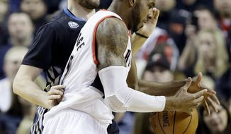 Portland Trail Blazers forward LaMarcus Aldridge, right, loses his grip on the ball as he drives on Minnesota Timberwolves forward Kevin Love during the first half of an NBA basketball game in Portland, Ore., Saturday, Jan. 25, 2014. (AP Photo/Don Ryan)