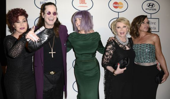 From left, Sharon Osbourne, Ozy Osbourne, Kelly Osbourne, Joan Rivers and Melissa Rivers arrive at the 56th annual GRAMMY awards - salute to industry icons with Clive Davis, on Saturday, Jan. 25, 2014, in Beverly Hills, Calif. (Photo by Dan Steinberg/Invision/AP)