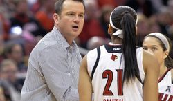 Louisville head coach Jeff Walz, left, talks with Bria Smith during the first half of an NCAA basketball game against Memphis Sunday, Jan. 26, 2014 in Louisville, Ky. (AP Photo/Timothy D. Easley)