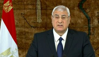 In this image made from video broadcast on Egyptian State Television, Egypt's interim President Adly Mansour speaks at the presidential palace in Cairo, Egypt, Sunday, Jan. 26, 2014. Egypt's interim president says he is amending the country's transitional plan to allow for presidential elections before parliamentary polls. According to Egypt's new constitution, the presidential vote is to be held before the second half of April, 2014. (AP Photo/Egyptian State Television)
