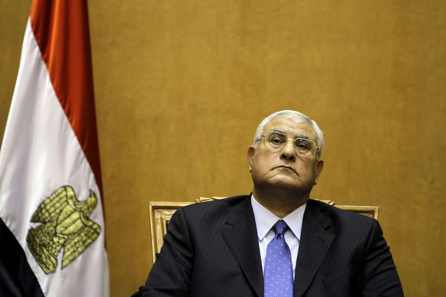 FILE - In this Thursday, July 4, 2013 file photo, Egypt's chief justice Adly Mansour prepares to be sworn in as the nation's interim president. In a televised speech Sunday, Jan. 26, 2014, Egypt's interim president, Adly Mansour, says he is amending the country's transitional plan to allow for presidential elections before parliamentary polls. According to Egypt's new constitution, the presidential vote is to be held before the second half of April. (AP Photo/Amr Nabil, File)