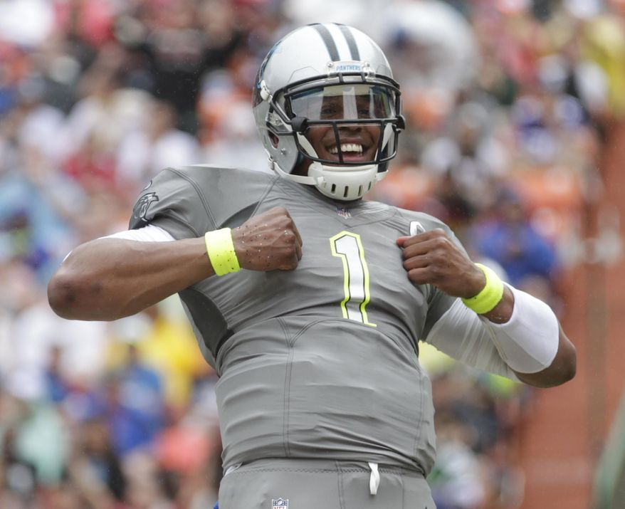Carolina Panthers quarterback Cam Newton (1) of Team Sanders celebrates his touchdown in the second quarter quarter of the NFL Pro Bowl football game, Sunday, Jan. 26, 2014, in Honolulu. (AP Photo/Eugene Tanner)