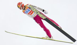 World Cup leader Eric Frenzel of Germany  soars through the air during the individual Gundersen competition at the Nordic Combined FIS World Cup in Oberstdorf, southern Germany, Sunday, Jan. 26, 2014. He placed third after the jumping. (AP Photo/Jens Meyer)