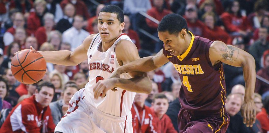 Nebraska Cornhuskers guard Tai Webster (0) drives by Minnesota Golden Gophers guard Deandre Mathieu (4) during their Sunday, Jan 26, 2014 NCAA basketball game at the Pinnacle Bank Arena in Lincoln, Neb. (AP Photo/Dave Weaver)