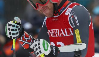 Bode Miller of United States stands in the finish area after he placed second at an alpine ski men's World Cup Super G in Kitzbuehel, Austria, Saunday, Jan. 26, 2014. (AP Photo/Giovanni Auletta)