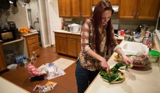 Maggie Barcellano prepares dinner at her father's house in Austin, Texas on Saturday, Jan. 25, 2014. Barcellano, who lives with her father, enrolled in the food stamps program to help save up for paramedic training while she works as a home health aide and raises her three-year-old daughter. Working-age people now make up the majority in U.S. households that rely on food stamps, a switch from a few years ago when children and the elderly were the main recipients.  (AP Photo/Tamir Kalifa)