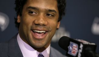 Seattle Seahawks quarterback Russell Wilson speaks during a news conference Sunday, Jan. 26, 2014, in Jersey City, N.J. The Seahawks and the Denver Broncos are scheduled to play in the Super Bowl XLVIII football game Sunday, Feb. 2, 2014. (AP Photo/Jeff Roberson)