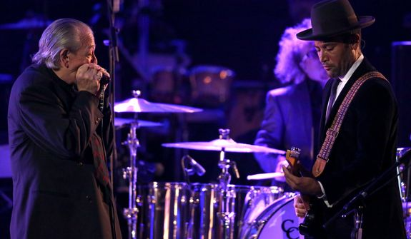 Charlie Musselwhite, left, and Ben Harper perform at the pre-telecast of the 56th annual Grammy Awards on Sunday, Jan. 26, 2014, in Los Angeles. (Photo by Matt Sayles/Invision/AP)