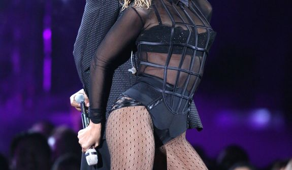 "Beyonce, foreground, and Jay-Z perform ""Drunk in Love"" at the 56th annual Grammy Awards at Staples Center on Sunday, Jan. 26, 2014, in Los Angeles. (Photo by Matt Sayles/Invision/AP)"