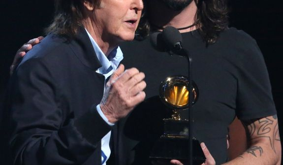 "Paul McCartney, left, and Dave Grohl, accept the award for best rock song for ""Cut Me Some Slack"" at the 56th annual Grammy Awards at Staples Center on Sunday, Jan. 26, 2014, in Los Angeles. (Photo by Matt Sayles/Invision/AP)"