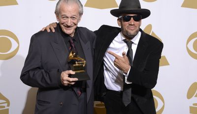 "Charlie Musselwhite, left, and Ben Harper pose with the best blues album award for ""Get Up!"" in the press room at the 56th annual Grammy Awards at Staples Center on Sunday, Jan. 26, 2014, in Los Angeles. (Photo by Dan Steinberg/Invision/AP)"