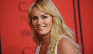 "FILE - This June 3, 2013 file photo shows alpine ski racer Lindsey Vonn at the 2013 CFDA Fashion Awards in New York. Vonn will be working for NBC during the Winter Olympics, although she won't be traveling to Sochi. The network said Monday, Jan. 27, 2014, that the gold medalist will report on the Olympics for the ""Today"" show and some NBC Sports broadcasts. Vonn was expected to defend her championship at the Olympics, which begin next week. But a leg injury has kept her out of the competition, and is preventing her from going to Russia. (Photo by Brad Barket/Invision/AP, File)"
