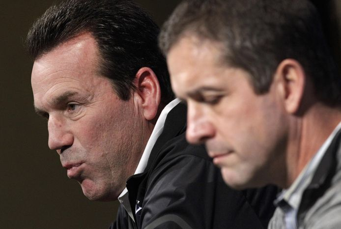 Baltimore Ravens offensive coordinator Gary Kubiak, left, speaks alongside head coach John Harbaugh at an introductory NFL football news conference, Monday, Jan. 27, 2014, in Owings Mills, Md. Kubiak, The former Houston Texans head coach replaces Jim Caldwell, who left to become coach of the Detroit Lions. (AP Photo/Patrick Semansky)