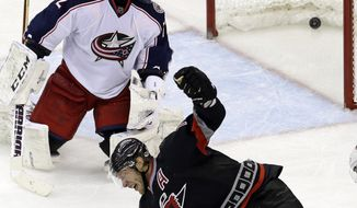 Carolina Hurricanes' Jordan Staal celebrates his game-winning goal against Columbus Blue Jackets goalie Sergei Bobrovsky, of Russia, during the third period of an NHL hockey game in Raleigh, N.C., Monday, Jan. 27, 2014. Carolina won 3-2. (AP Photo/Gerry Broome)