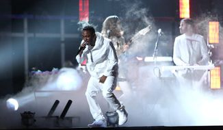 Kendrick Lamar performs  at the 56th annual Grammy Awards at Staples Center on Sunday, Jan. 26, 2014, in Los Angeles. (Photo by Matt Sayles/Invision/AP)