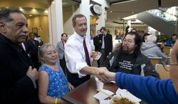 Maryland Gov. Martin O'Malley shakes hands with customers at the Mall in Columbia, Md, after the mall was reopened to the public on Monday, Jan. 27, 2014. Three people died Saturday in a shooting at a mall in suburban Baltimore, including the presumed gunman. (AP Photo/Jose Luis Magana)