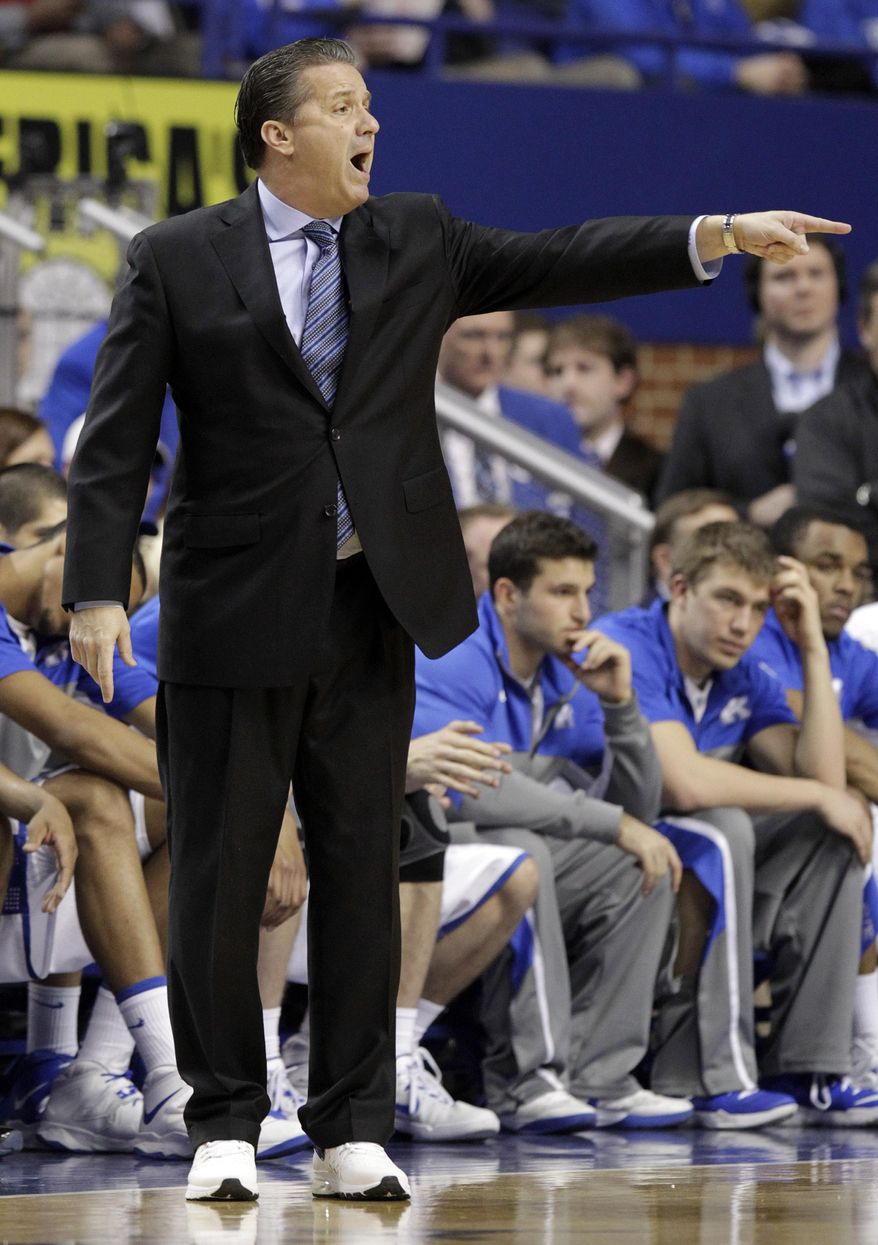 Kentucky head coach John Calipari directs his team during the first half of an NCAA college basketball game against Georgia, Saturday, Jan. 25, 2014, in Lexington, Ky.  Coaches from both teams wore sneakers to bring awareness to the Coaches vs. Cancer program. (AP Photo/James Crisp)