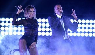 "Beyonce, left, and Jay-Z perform ""Drunk in Love"" at the 56th annual Grammy Awards at Staples Center on Jan. 26, 2014, in Los Angeles. (Associated Press) ** FILE **"