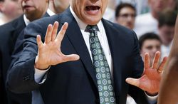 Michigan State coach Tom Izzo gives instructions during the first half of an NCAA college basketball game against Michigan, Saturday, Jan. 25, 2014, in East Lansing, Mich. Michigan won 80-75. (AP Photo/Al Goldis)