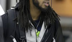 Seattle Seahawks' Richard Sherman arrives at Newark Liberty International Airport for the NFL Super Bowl XLVIII football game, Sunday, Jan. 26, 2014, in Newark, N.J. (AP Photo/Julio Cortez)
