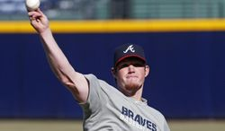 Atlanta Braves closer Craig Kimbrel throws during the first day of voluntary workouts for pitchers Monday, Jan. 27, 2014, in Atlanta. (AP Photo/John Bazemore)