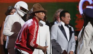 Pharrell Williams, second from left, and Daft Punk accept the award for record of the year at the 56th annual Grammy Awards at Staples Center on Sunday, Jan. 26, 2014, in Los Angeles. (Photo by Matt Sayles/Invision/AP)