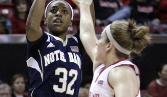 Notre Dame guard Jewell Loyd, left, shoots over Maryland guard Katie Rutan in the first half of an NCAA college basketball game in College Park, Md., Monday, Jan. 27, 2014. (AP Photo/Patrick Semansky)