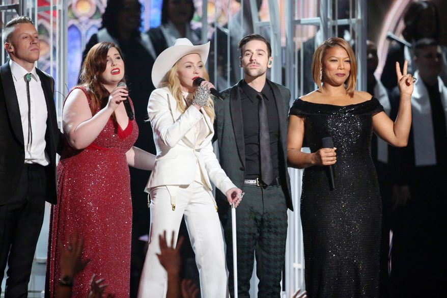"""Performers, from left, Macklemore, Mary Lambert, Madonna, Ryan Lewis and Queen Latifah appear on stage during a performance of """"Same Love"""" at the 56th annual Grammy Awards at Staples Center on Sunday, Jan. 26, 2014, in Los Angeles. (Photo by Matt Sayles/Invision/AP)"""