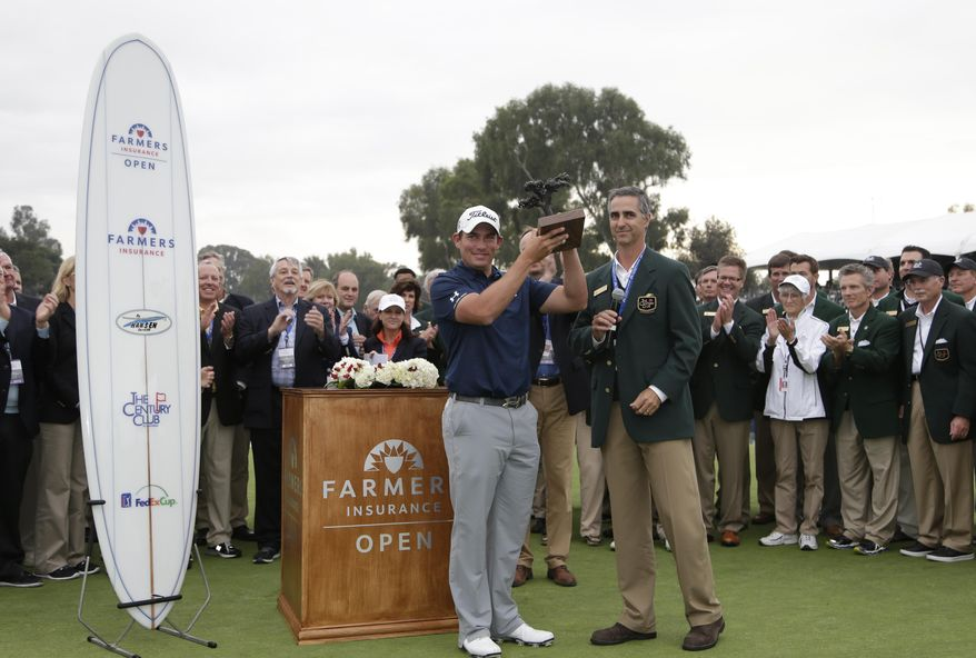 Scott Stallings holds the trophy after winning the Farmers Insurance Open golf tournament, Sunday, Jan. 26, 2014, in San Diego. (AP Photo/Gregory Bull)