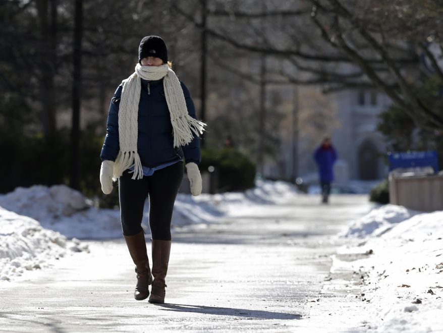 A student on the campus of Butler University walks to her class Monday, Jan. 27, 2014, in Indianapolis. Below-zero high temperatures have returned to many parts of the Midwest bringing with it wind chills ranging from the negative teens to 40-below. (AP Photo/Darron Cummings)