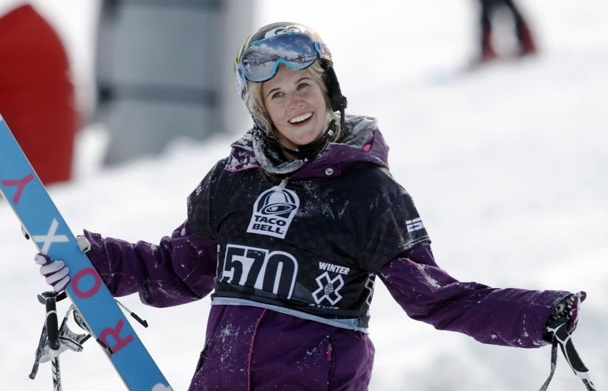 "FILE - In a Jan. 28, 2010, file photo, Sarah Burke, of Canada, reacts after failing to place in the top-three finishers in the slopestyle skiing women's final at the Winter X Games at Buttermilk Mountain outside Aspen, Colo. Burke died Jan. 19, 2012, nine days after a training accident on a halfpipe in Park City, Utah, and about nine months after the International Olympic Committee said ""yes"" to her longtime dream. Burke's friends will bring their snowflakes to the Olympic Games in Sochi, Russia, wearing necklaces shaped like the snowflake tattoo the late Canadian star had etched on her foot. (AP Photo/David Zalubowski, File)"