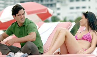 In this undated photo provided by Reel Miami Project, a couple, played by Eric Aragon and Elisabetta Fantone, sit on Miami Beach. The Reel Miami Project is planned as a series of six short films, each featuring different story lines set in neighborhoods around Miami. Films for Miami Beach and Wynwood have already been released, with films featuring South Beach, Downtown Miami, Coral Gables and the Everglades set to follow. (AP Photo/Reel Miami Project)