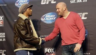 Mixed martial Arts fighter Benson Henderson, left, shakes hands with Dana White, president of the UFC,  during a media availability at the United Center for his upcoming UFC fight, Thursday, Jan. 23, 2014, in Chicago. Henderson will face off against Josh Thomson on Saturday, Jan. 25, 2014. (AP Photo/Nam Y. Huh)
