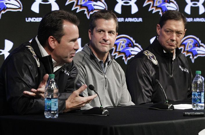 Baltimore Ravens head coach John Harbaugh, center, and quarterbacks coach Rick Dennison, right, listen as offensive coordinator Gary Kubiak speaks at an NFL football news conference, Monday, Jan. 27, 2014, in Owings Mills, Md. The former Houston Texans head coach replaces Jim Caldwell, who left to become coach of the Detroit Lions. (AP Photo/Patrick Semansky)