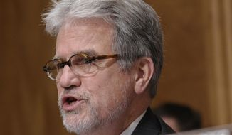 ** FILE ** In this Dec. 17, 2013, file photo, Sen. Tom Coburn, R-Okla., speaks on Capitol Hill in Washington. (AP Photo/Susan Walsh, File)