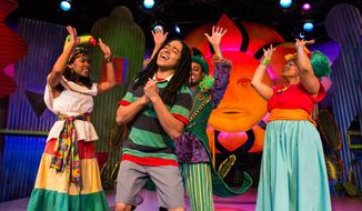 "This image released by the New Victory Theater shows, for left, Tara Yates-Reeves, Jobari Parker, David Little and Ayanna Hardy during a performance of ""Bob Marley's Three Little Birds,"" a new musical for kids that features the legendary reggae artist's songs. (AP Photo/New Victory Theater, Michael Horan)"