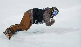 Danny Davis celebrates after his final run in the Men's Snowboard SuperPipe final at the 18th edition of the Winter X Games in Aspen, Colo. Sunday, Jan. 26, 2014. Davis took home his first gold with a score of 95.00.(AP Photo/ The Gazette, Michael Ciaglo)