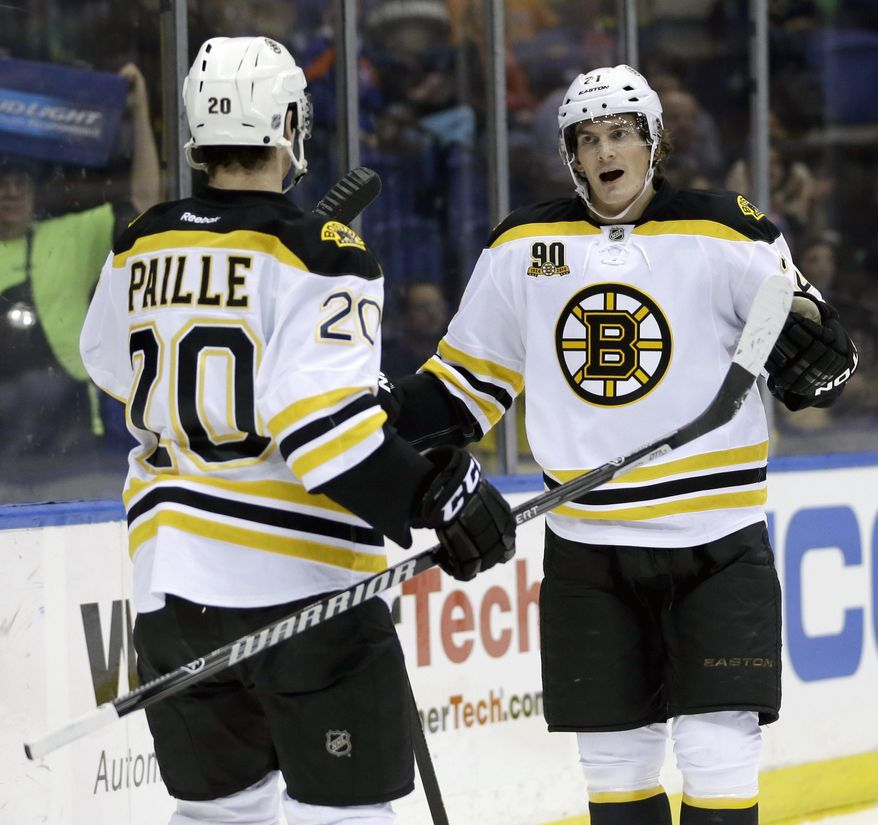 Boston Bruins' Loui Eriksson, right, celebrates his goal with teammate Daniel Paille during the first period of the NHL hockey game against the New York Islanders, Monday, Jan. 27, 2014, in Uniondale, New York. (AP Photo/Seth Wenig)