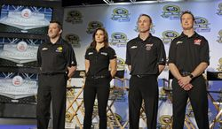 Drivers from Stewart-Haas racing, from left, Tony Stewart, Danica Patrick, Kevin Harvick and Kurt Busch, pose for a photo during a news conference at the NASCAR Sprint Cup auto racing Media Tour in Charlotte, N.C., Monday, Jan. 27, 2014. (AP Photo/Chuck Burton)