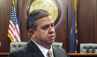Superintendent of Public Instruction Tom Luna, a Republican, speaks to reporters after he announced Monday, Jan. 27, 2014 at the Idaho Capitol that he won't run for a third term in 2014. (AP Photo/John Miller)