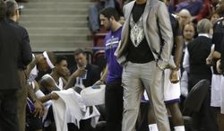 Sacramento Kings forward Rudy Gay grimaces as he walks on the court during a timeout in the closing moments of the Kings 125-117 loss to the Denver Nuggets in a NBA basketball game in Sacramento, Calif., Sunday, Jan. 26, 2014. Gay and Kings center DeMarcus Cousins did not suit up for the game due to injuries.(AP Photo/Rich Pedroncelli)