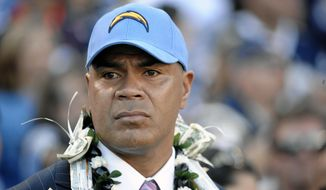 FILE - This Nov. 27, 2011 file photo shows late NFL star Junior Seau during his induction into the San Diego Chargers Hall of Fame in San Diego. The family of Junior Seau plans to object to the proposed $765 million settlement of player concussion claims because the fund would not pay wrongful death claims to survivors. (AP Photo/Denis Poroy, file)