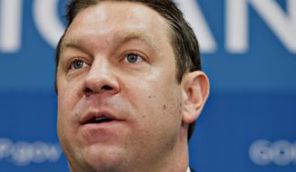 "FILE - In this July 9, 2013 file photo, Rep. Henry ""Trey"" Radel, R-Fla. speaks in Washington. A spokesman for Radel says the congressman will resign after pleading guilty to cocaine-possession charges last year. (AP Photo/J. Scott Applewhite, File)"