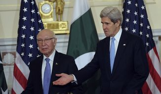 Secretary of State John Kerry and Pakistani National Security and Foreign Affairs Adviser Sartaj Aziz arrive for the start of the U.S.-Pakistan Strategic Dialogue Plenary Session at the State Department in Washington, Monday, Jan. 27, 2014. (AP Photo/Susan Walsh)