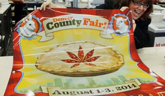 Dana Cain, director of the Denver County Fair, shows a poster advertising the fair at a print shop in Denver, Monday Jan. 27, 2014.  Colorado's Denver County is adding cannabis-themed contest to its 2014 summer fair. (AP Photo/Ed Andrieski)