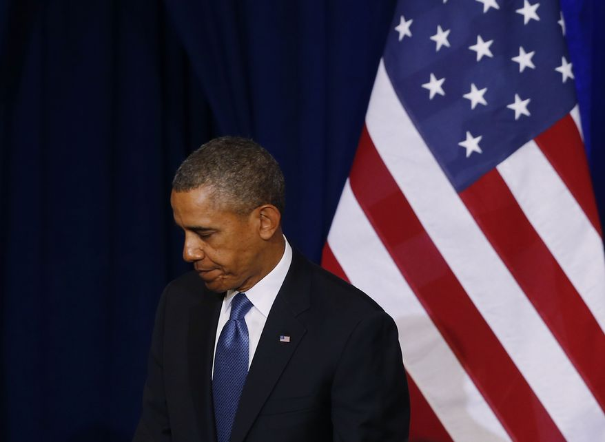 **FILE** President Obama turns to leave the stage Jan. 17, 2014, at the Justice Department in Washington after he spoke about National Security Agency surveillance. (Associated Press)
