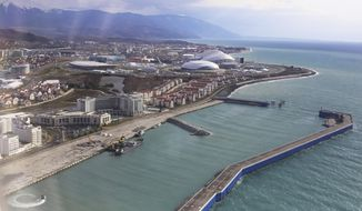 A view of the Olympic Park and seaside of the Russian Black Sea resort of Sochi, Russia, Monday, Jan. 27, 2014. Russia has spent about $51 billion to deliver the Winter Olympics in Sochi, which run Feb. 7-23. (AP Photo/Pavel Golovkin)