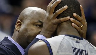 Georgetown head coach John Thompson III talks with Aaron Bowen (23) during the second half of an NCAA college basketball game against Villanova, Monday, Jan. 27, 2014, in Washington. Villanova won 65-60. (AP Photo/Alex Brandon)